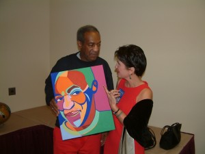 Bill Cosby & artist Marcia Gawecki with portrait. Photo courtesy Pechanga Casino